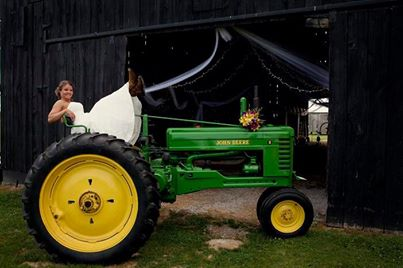 Having the bride (or bride and groom) show up on a tractor adds fun and sets the stage for your Vermont Barn Wedding.
