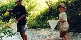 Vermont boys out fishing in river
